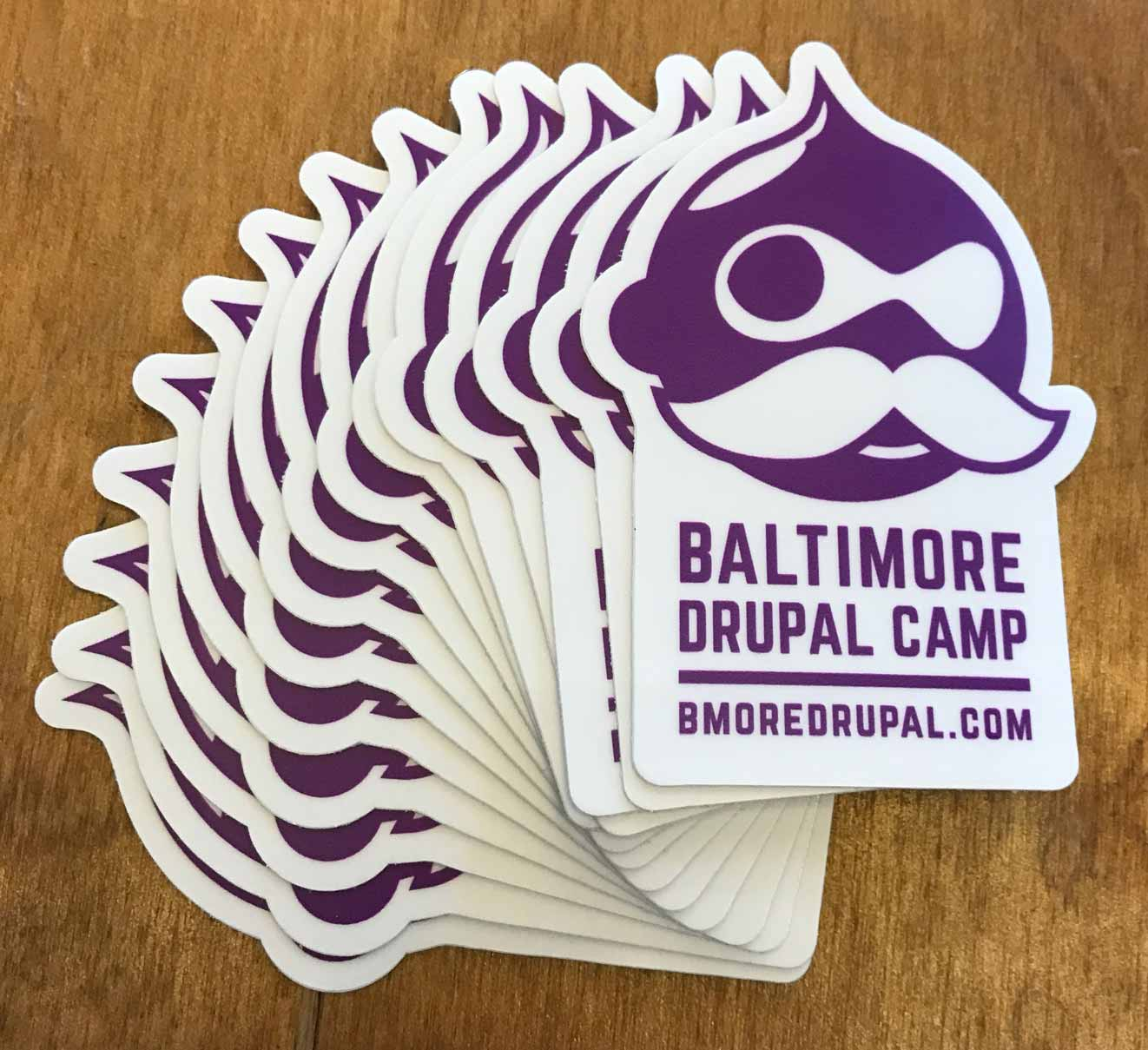 Baltimore Drupal Camp stickers with Drupal Boh icon