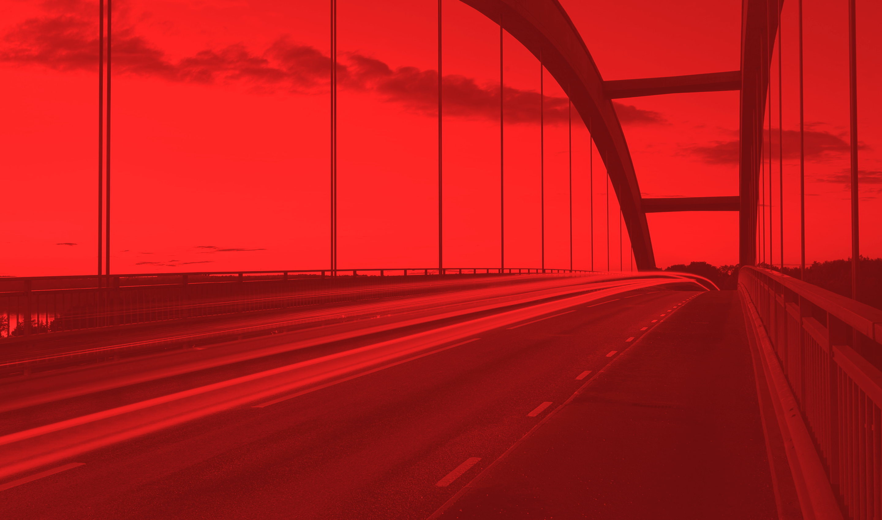 highway bridge with vehicles moving across it with a red mask