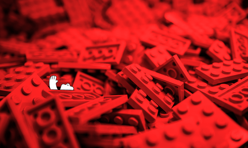 a happy yeti, potentially drowning in a sea of red legos