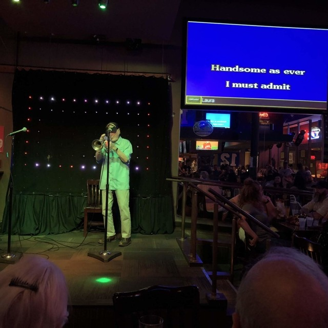 The Common Interest Karaoke Bar & Grill with someone performing on stage
